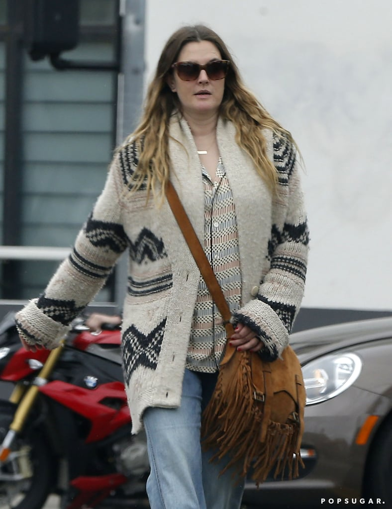 Drew Barrymore was spotted out on a stroll with longtime friend Chris Miller in LA on Saturday afternoon wearing one noticeable accessory: her wedding ring. The pair looked calm and relaxed, talking among themselves and flashing a couple smiles while making their way to a restaurant for lunch. Drew's outing comes a little over a week since news of her divorce from husband Will Kopelman broke. Since then, the couple has released a statement confirming the reports, and the actress even made her first postsplit appearance at the Pebble Beach Food & Wine Festival in Carmel, CA, last Saturday, where she spoke to POPSUGAR about how she finds her strength even in difficult times. Keep reading to see more of her casual outing, and then look back at her sweetest family moments.