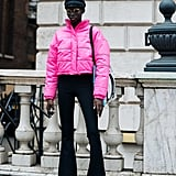 Amp up your black denim look with a bright pink or other neon puffer, influsing new life into your otherwise colorless winter wardrobe.