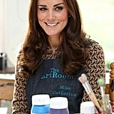 """Kate Middleton wore a smock that said """"Miss Catherine"""" during a visit to a primary school."""