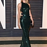 Striking a pose in this floor-length, sequinned Alexandre Vauthier Couture dress at the 2015 Vanity Fair Oscar Party in Los Angeles.