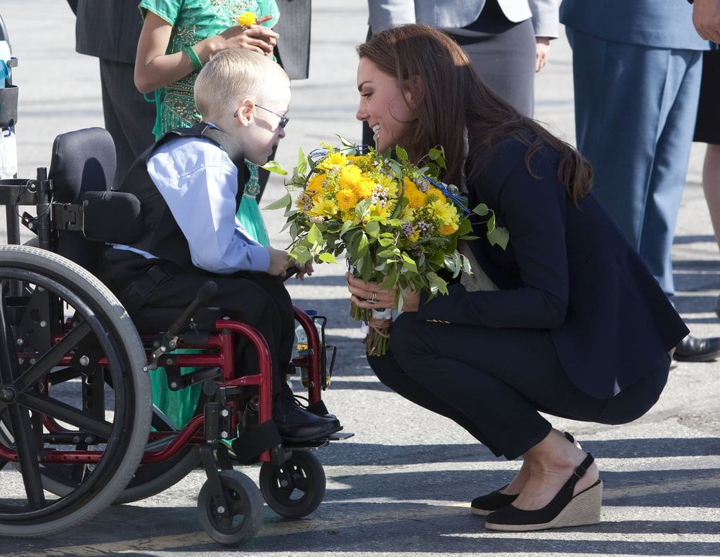 Kate shared an especially sweet moment with a little boy before departing from the Yellowknife airport in Canada in July 2011.