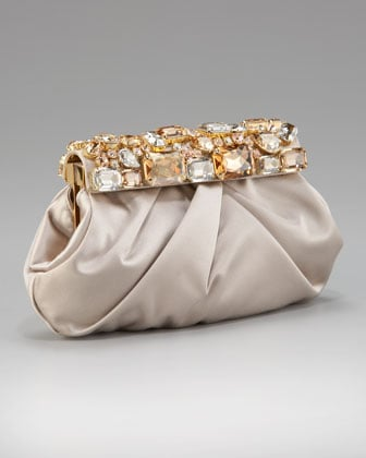 How exquisite are the jewels on this Prada stones satin frame clutch ($1,460)? The champagne hue is perfect for brides who are skipping bright white.