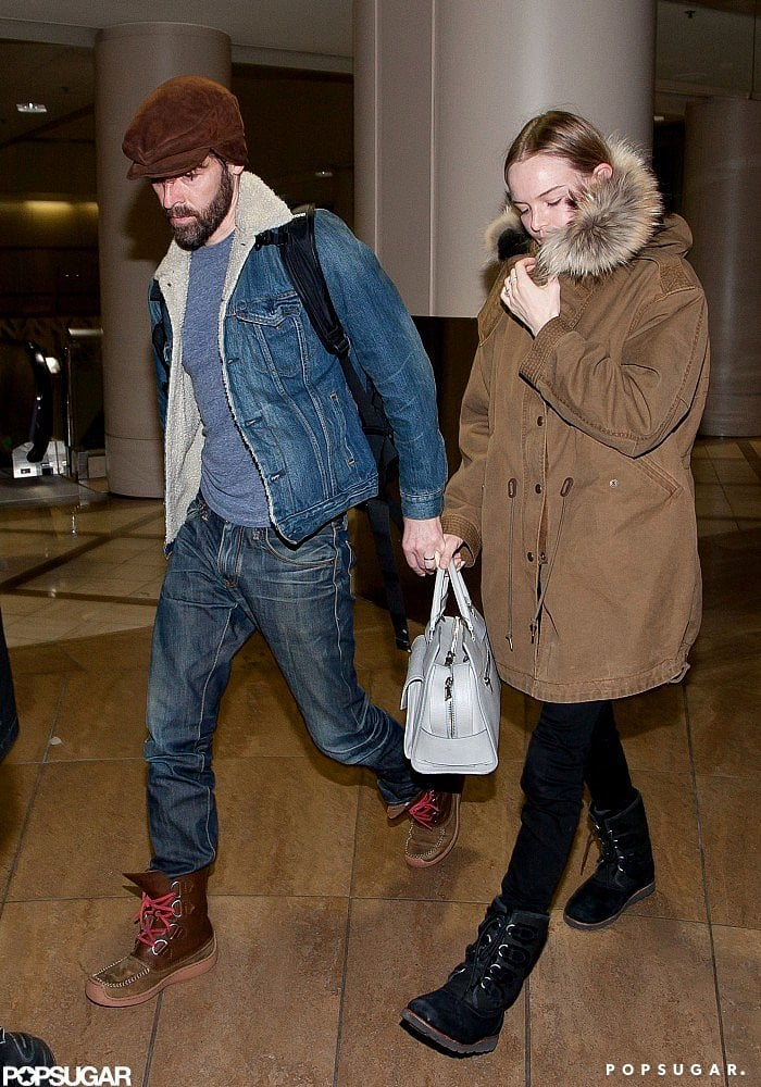 Kate Bosworth held hands with fiancé Michael Polish as they landed at LAX.