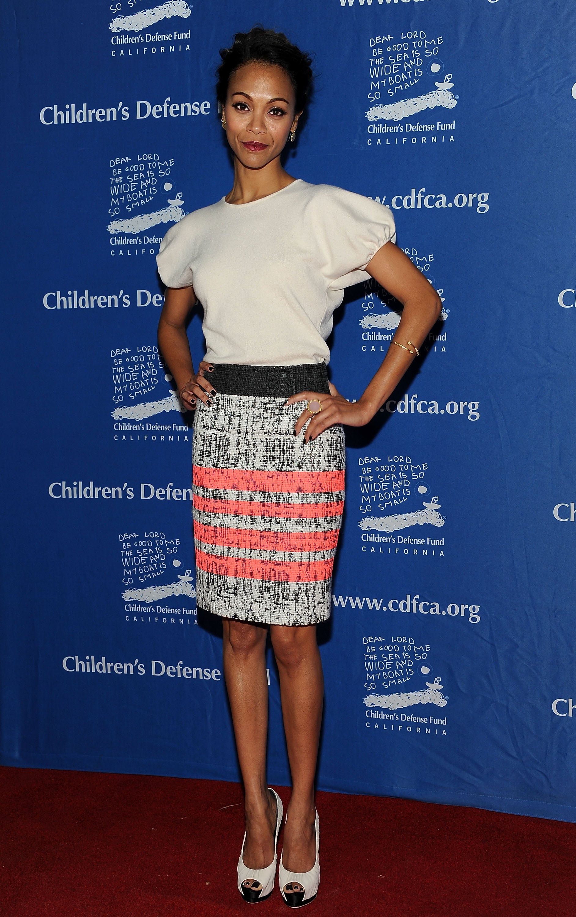 Her girlier Giambattista Valli sweater and textured skirt combo looked perfect on her in December 2011.