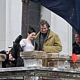 Anne Hathaway had a little help putting on a parka between scenes with Hugh Jackman.