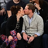 Drew planted a kiss on Will during a NY Knicks basketball game in January 2013.