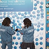 Two women added messages to the wall.