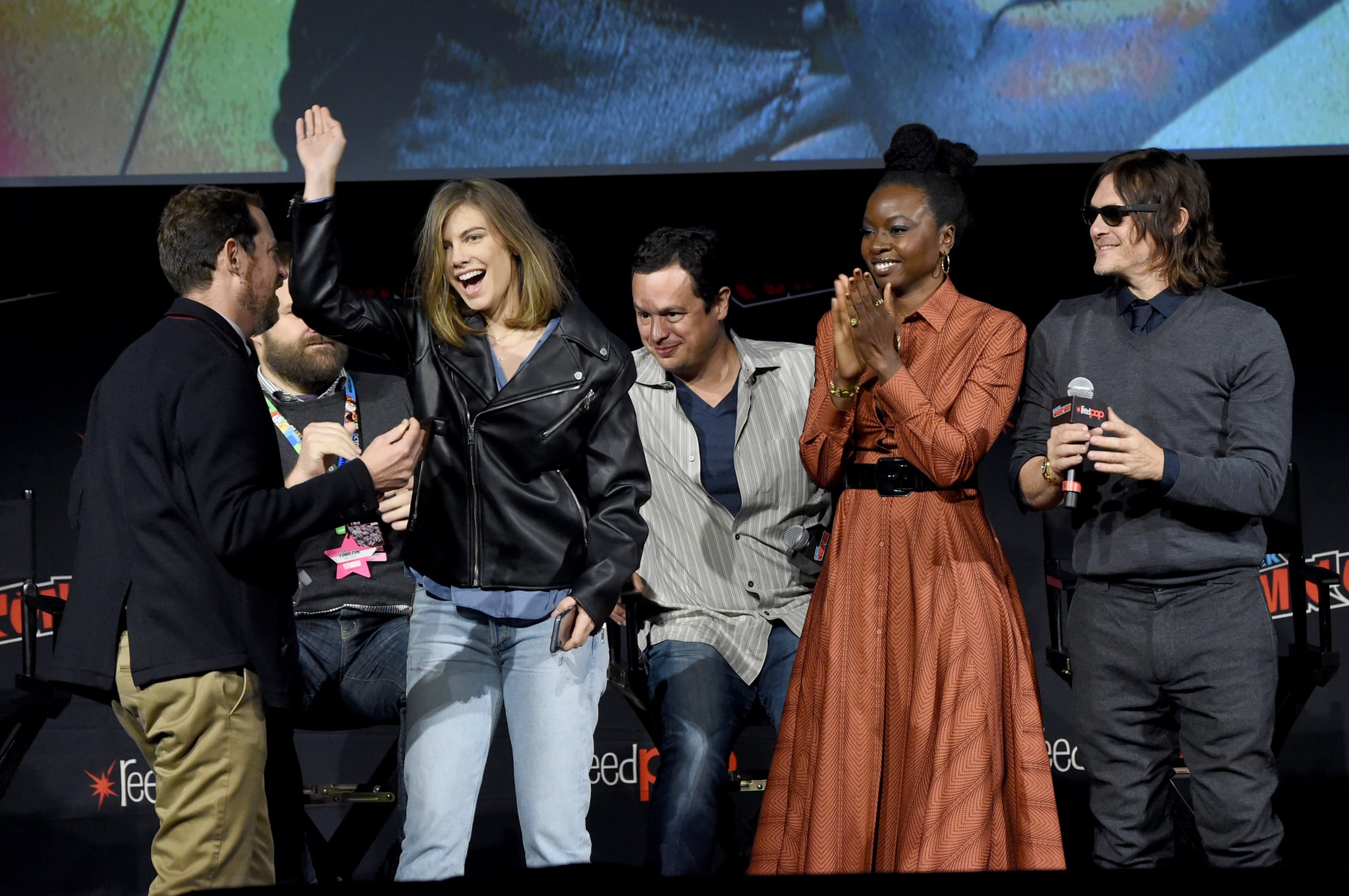 NEW YORK, NEW YORK - OCTOBER 05: (L-R) Scott Gimple, Robert Kirkman, Lauren Cohan, Dave Alpert, Danai Gurira and Norman Reedus speak onstage during a panel for AMC's The Walking Dead Universe including AMC's flagship series and the untitled new third series within The Walking Dead franchise at Hulu Theatre at Madison Square Garden on October 05, 2019 in New York City. (Photo by Jamie McCarthy/Getty Images for AMC)