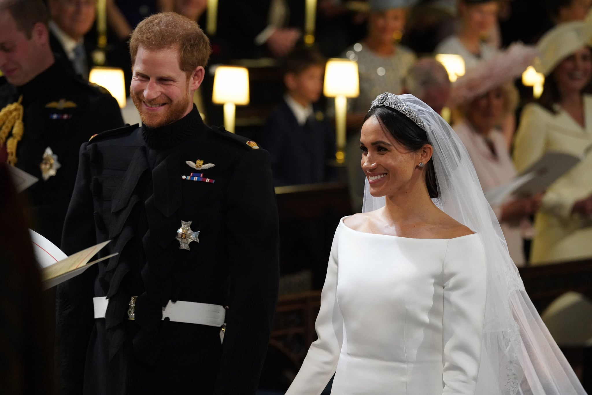 Britain's Prince Harry, Duke of Sussex, (L) and US fiancee of Britain's Prince Harry Meghan Markle arrive at the High Altar for their wedding ceremony in St George's Chapel, Windsor Castle, in Windsor, on May 19, 2018. (Photo by Jonathan Brady / POOL / AFP)        (Photo credit should read JONATHAN BRADY/AFP/Getty Images)