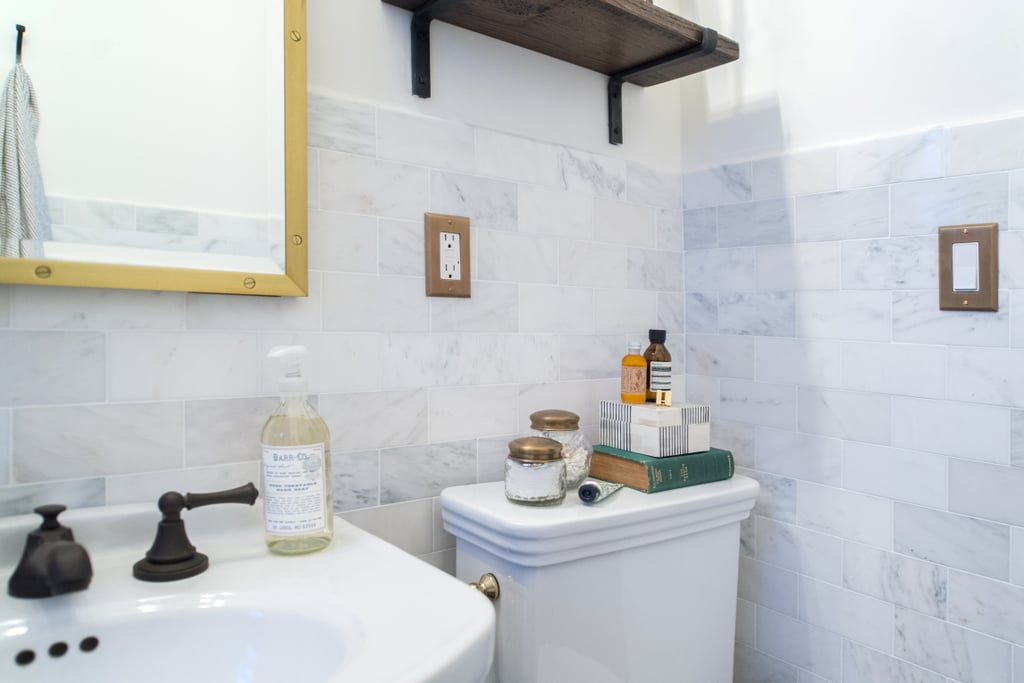 Another perk of a small bathroom? It's much more affordable to indulge in luxurious materials, like marble subway tile for the walls!  Photo by Samantha Goh via Homepolish