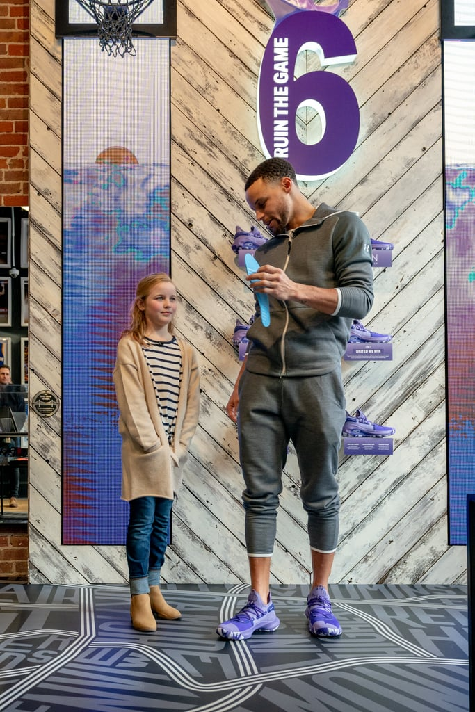 "Riley Morrison is just 9 years old, and she's changing the game for female athletes. In November, the young girl wrote a letter to three-time NBA champion Stephen Curry expressing her concern over the lack of girls' sizes in his Under Armour kids' basketball sneakers. Not only did Steph write back to Riley about how he was going to ""fix the issue,"" but they also worked together to design a new pair of basketball shoes for International Women's Day. On March 7, the day before the release of the new sneakers, Riley (who coincidentally has the same name as Steph's oldest daughter) joined the Golden State Warriors player to debut their hard work. Riley and Steph worked together on the UA ICON Curry 6 United We Win purple shoe, which features a sockliner designed by Riley. The liner has inspiring quotes like ""Girls Hoop Too,"" ""Play With Heart,"" ""Girl Power,"" and more. It's incredible to see Riley making such an impact for equality in the sports world at a young age. ""I was immediately impressed when I saw Riley's letter; that a 9-year-old girl had the courage to use her voice to call attention to an issue and keep us accountable,"" Steph said. ""She was focused on the opportunity for ALL girls, not just herself. She's been an amazing catalyst for change — not only with my product but also with the entire Under Armour brand. She is inspiring, and wise beyond her years."" The brand reports that proceeds from the United We Win sneakers will fund a scholarship from the Curry Family Foundation and Under Armour ""that will go to a young woman from the Oakland area pursuing an education in a STEM-related field."" Ahead, see all the photos from the inspiring International Women's Day event, and the awesome purple sneakers.      Related:                                                                                                           Steph Curry's Adorable Family Lives to Outshine Him"