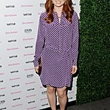 Ellie Kemper exuded a laid-back California vibe in her purple-printed Juicy Couture shirtdress. To add a bit of glamour, she styled it with a slick gold clutch and gold embellished platform sandals.