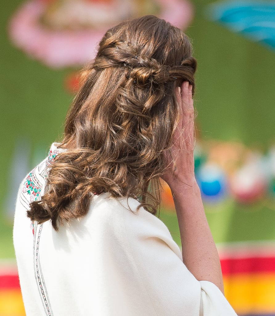 For a special event in Bhutan that involved a meet-and-greet — and even some archery! —the Duchess wore her hair up in an intricate half-up, half-down style.