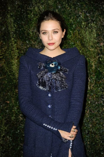 Elizabeth Olsen's coat — and check out her rings.