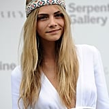 Cara Delevingne added a touch of hippie chic to her Serpentine Summer Party look in 2011 by wearing a hairband over the hair but high on the forehead.