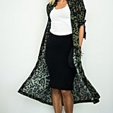With a Black Pencil Skirt, a Printed Duster, a Choker, and Black Pumps