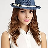 Don this blue raffia Genie by Eugenia Kim fedora ($88) with a sleeveless white blouse and floral skirt for a waterside lunch date.