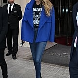 Gigi added another casual ensemble to her list of flawless street style looks — she tucked a graphic tee into skinny jeans and pointed-toe boots and finished with a luxe blue coat.