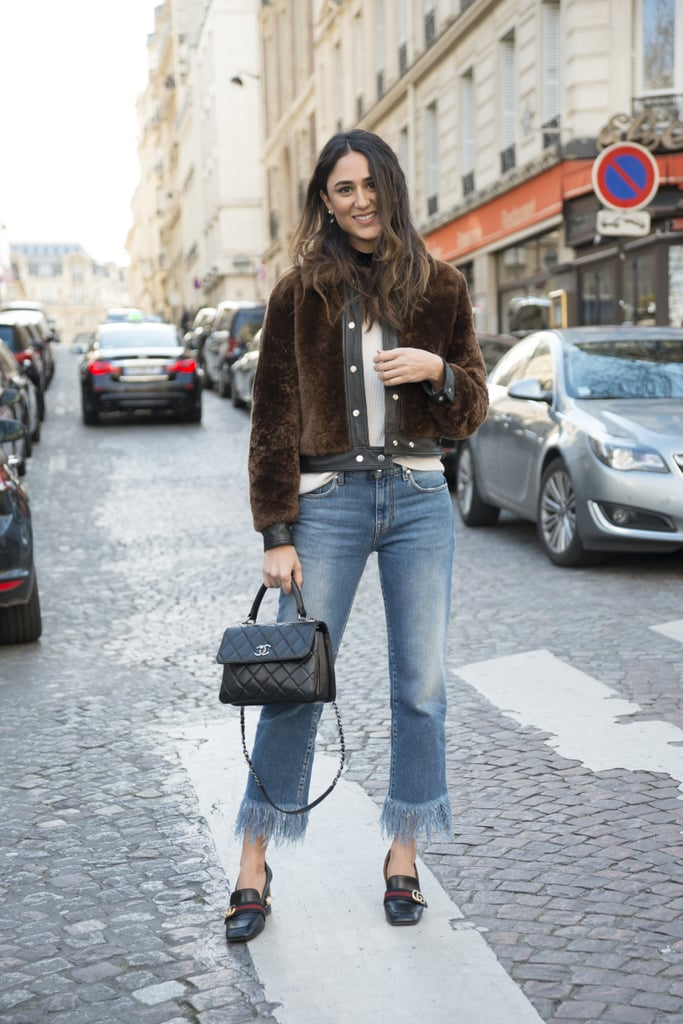 With a furry cropped jacket and loafers