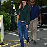 Katie's rich green blouse dressed up her casual skinny jeans in July 2012.