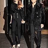 Chrissy Teigen stepped out hand in hand with John Legend wearing a one-shoulder furry textured top to match John's coat. She wore classic round hoop earrings by Jennifer Fisher.