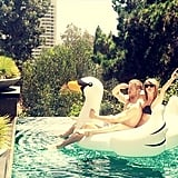 "The cute couple kicked off Summer 2015 together, floating on an inflatable swan in a ridiculously cute picture that Taylor captioned, ""Swan goals."""