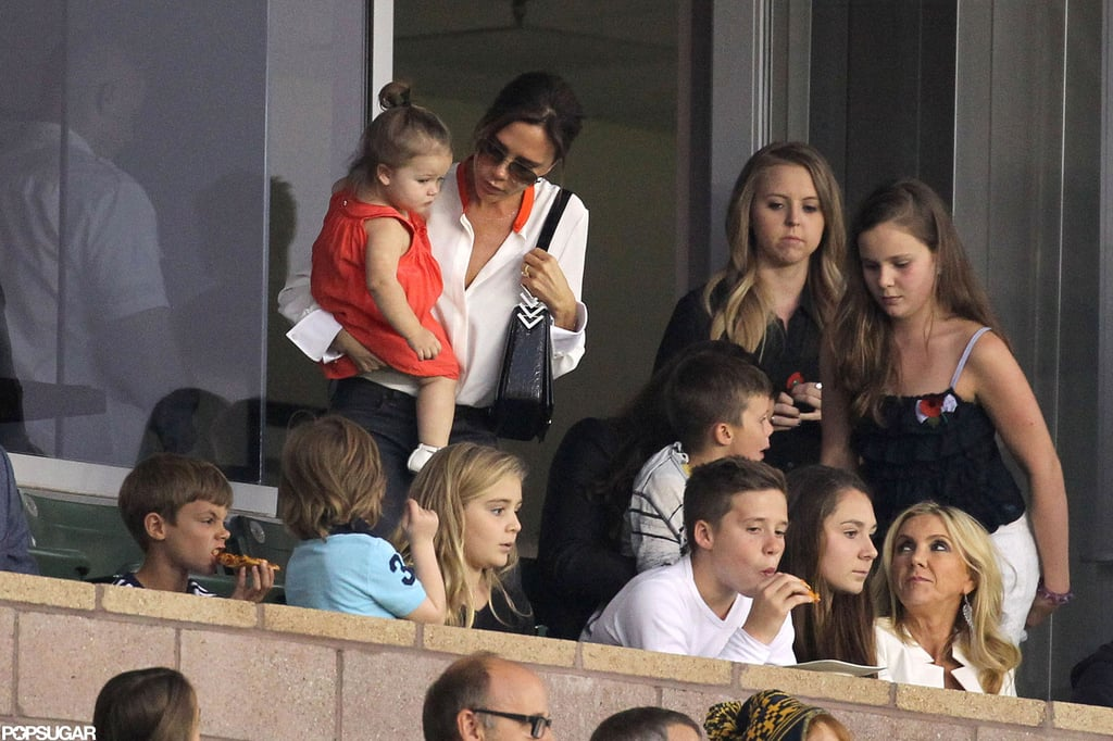 Victoria Beckham carried daughter Harper in LA.
