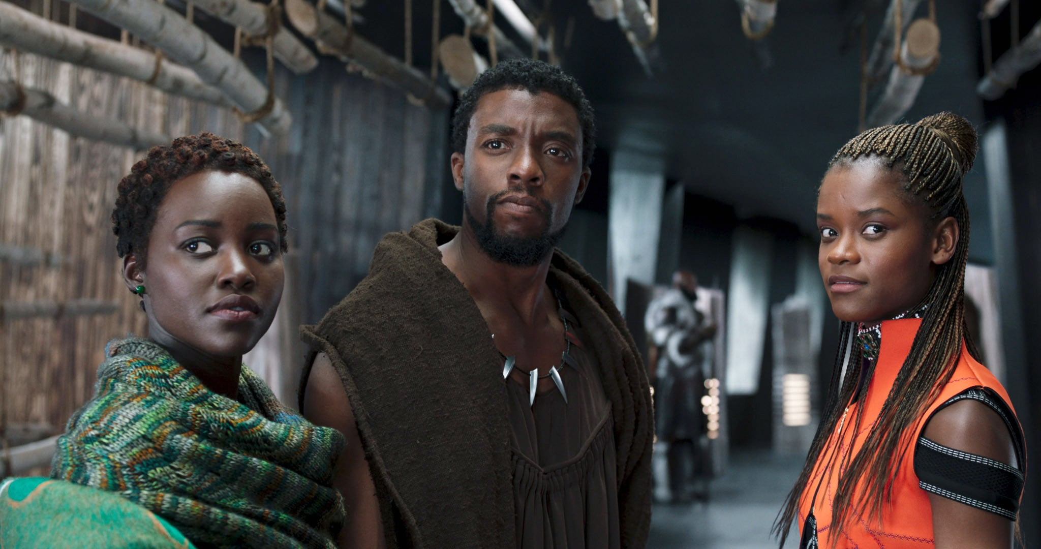 BLACK PANTHER, from left:  Lupita Nyongo, Chadwick Boseman, Letitia Wright, 2018.  Marvel /  Walt Disney Studios Motion Pictures /Courtesy Everett Collection