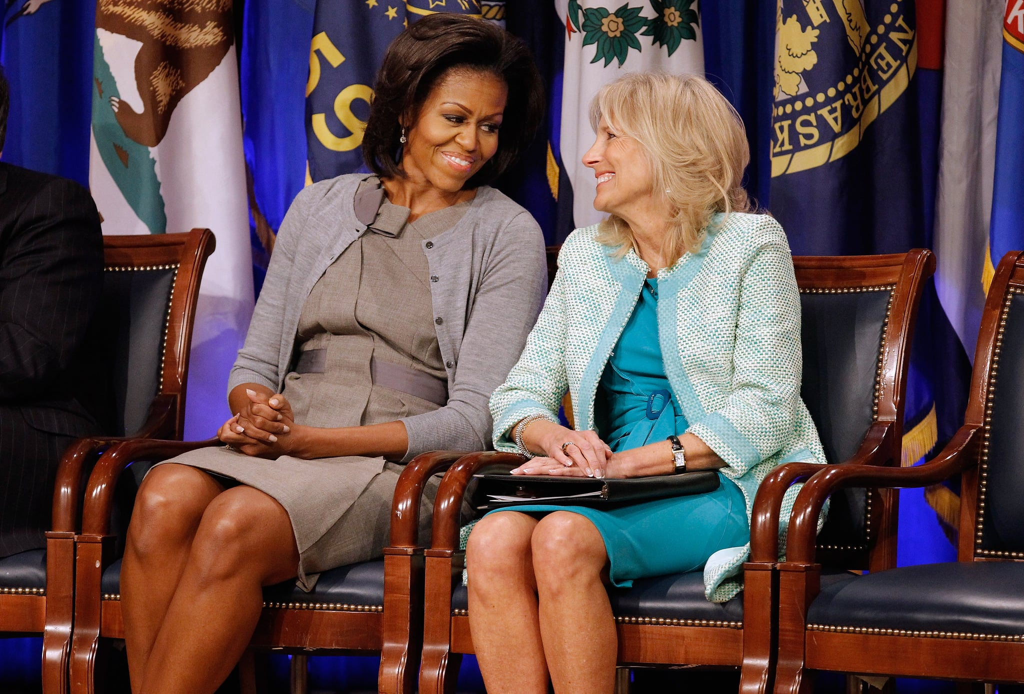 ARLINGTON, VA - FEBRUARY 15:  U.S. first lady Michelle Obama (L) and Dr. Jill Biden attend an event to announce a new report regarding military spouse employment at the Pentagon February 15, 2012 in Arlington, Virginia. The report,