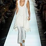 A breezy white dress over sleek white pants.