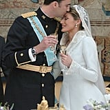In May 2004, Felipe gave Letizia a tender kiss on their wedding day.