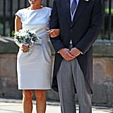 Mike Tindall's best man, Iain Balshaw, stands with Zara's maid of honor, Dolly Maude.