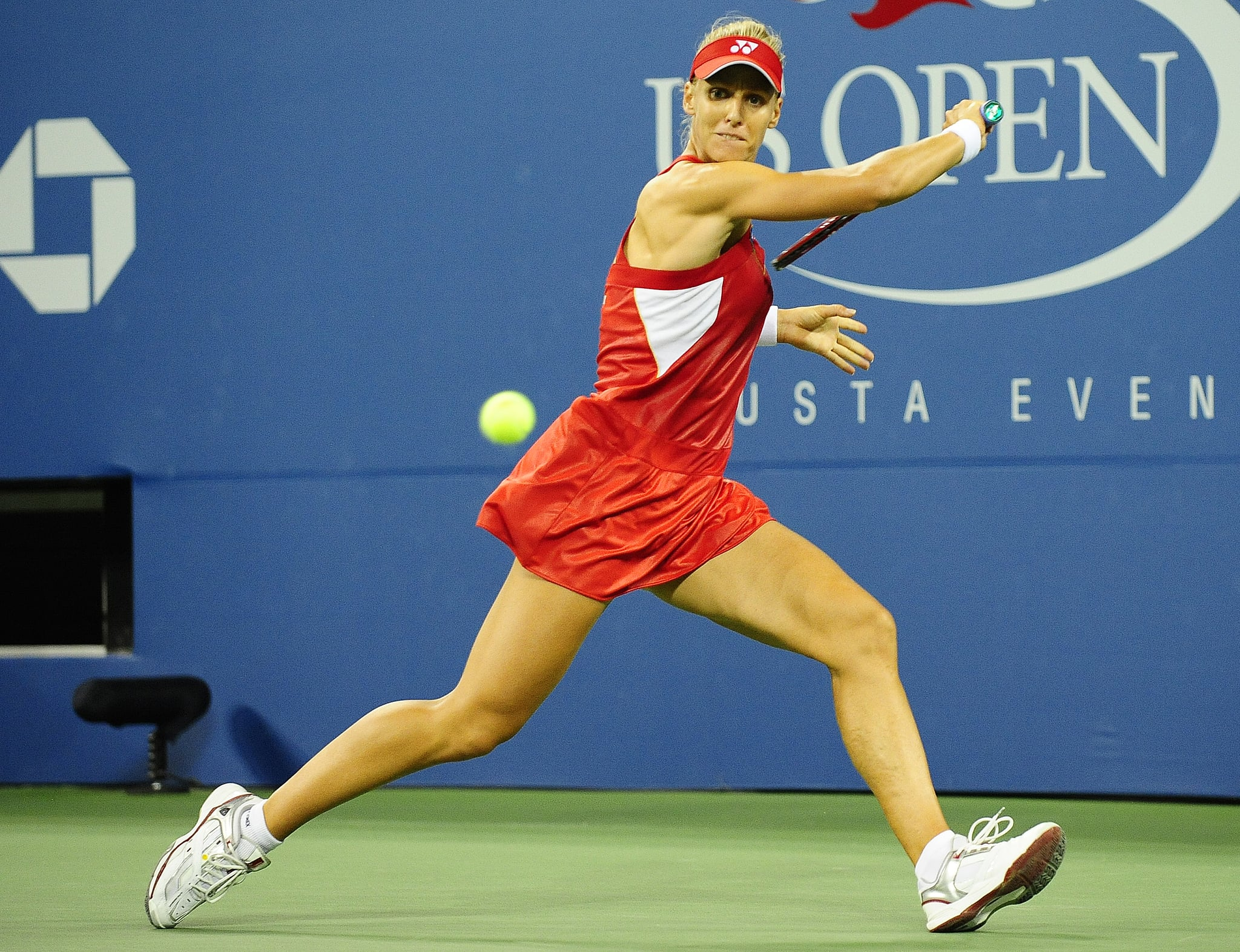 Elena Dementieva wore a loose red and white tennis dress with a matching visor to the 2010 US Open.