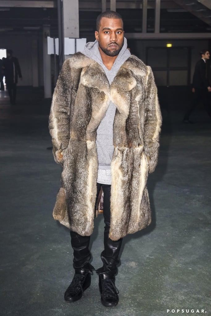 Kanye West rocked a fur coat at Paris Fashion Week on Friday.