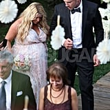 Jessica Simpson walked with fiancé Eric Johnson at a wedding.