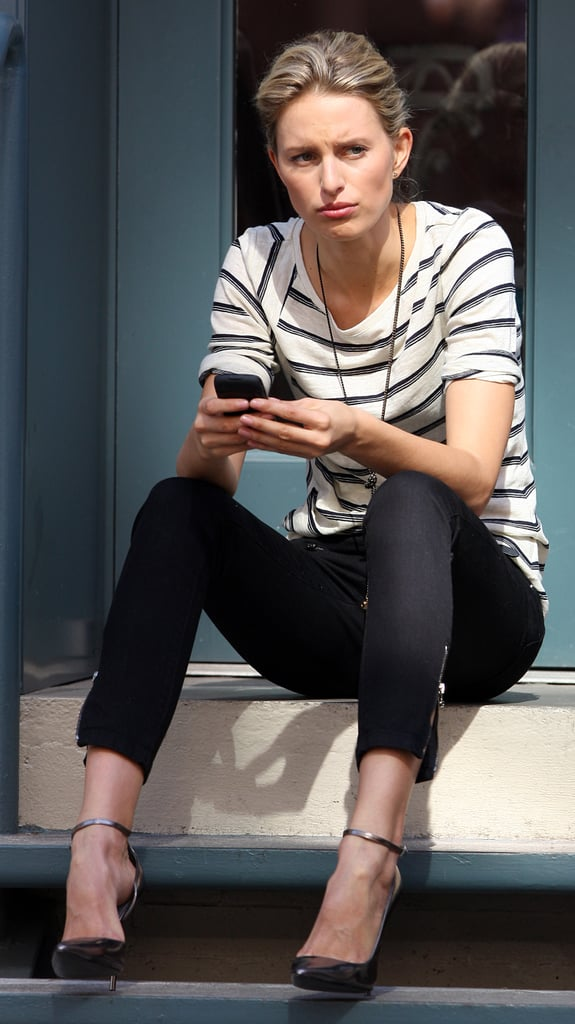 Only Karolina Kurkova could make sitting on a stoop look quite so fashionable. Striped top, skinny jeans and thin-strap pointed heels. Simple, classic, perfect.