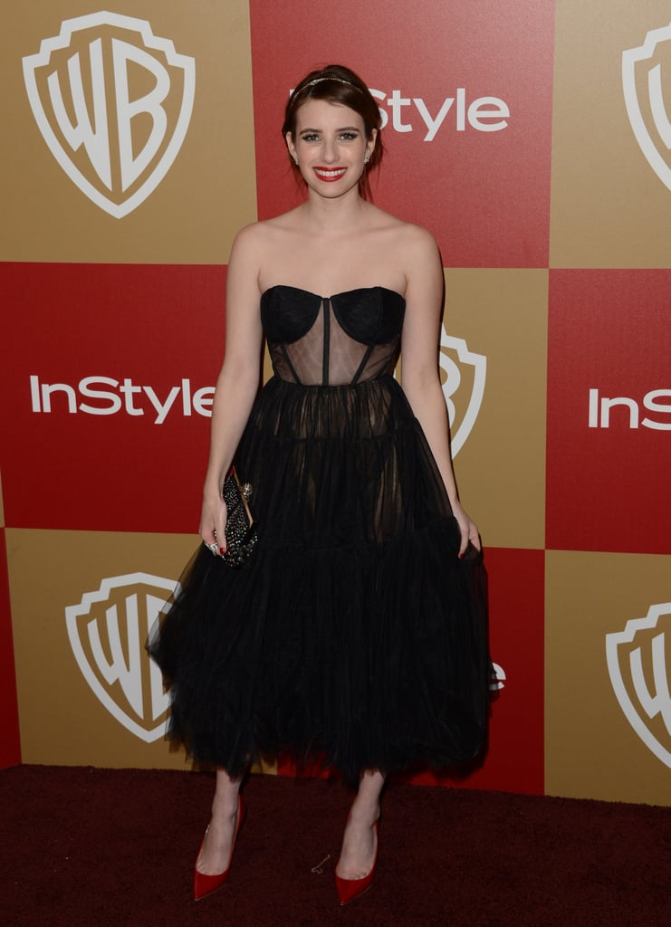 Emma Roberts struck a sexy lingerie-inspired note in this black corseted dress. And what boudoir cocktail dress doesn't deserve its red-pump complement? This look is red hot.