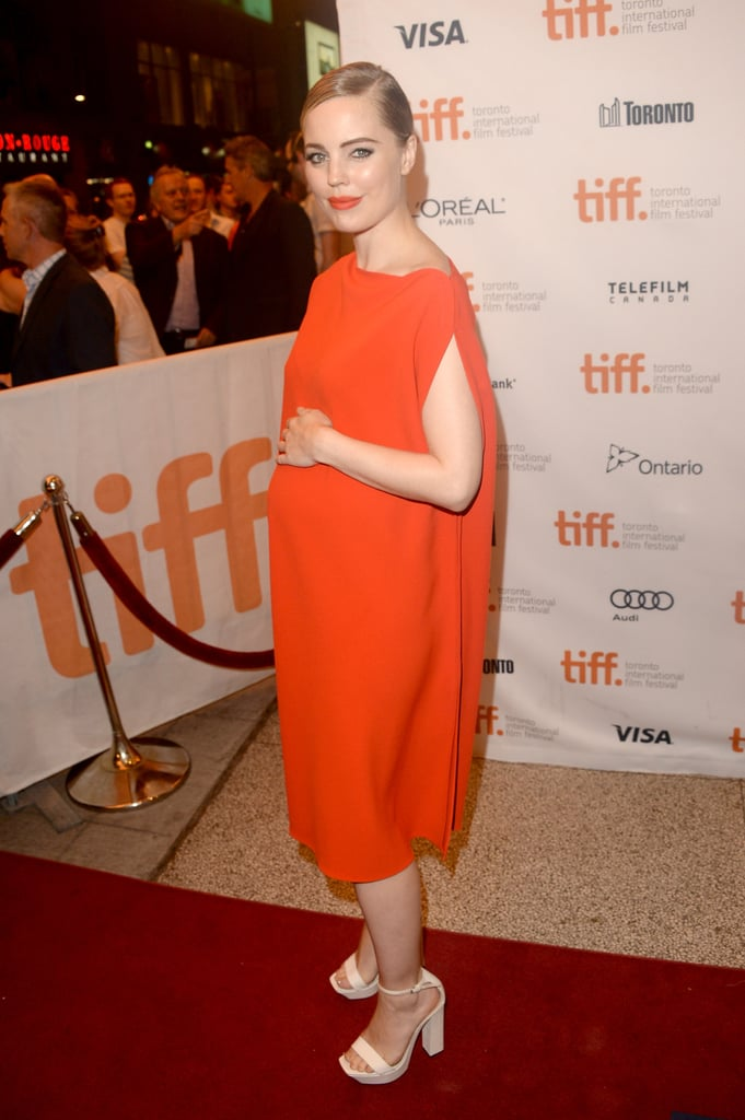 Pregnant Melissa George showed off her baby bump at the premiere of Felony.