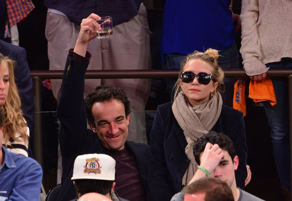 Mary-Kate Olsen and Olivier Sarkozy celebrated and raised their glasses at the game.