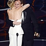 Charlize Theron hugged Quentin Tarantino at the 2013 Oscars.