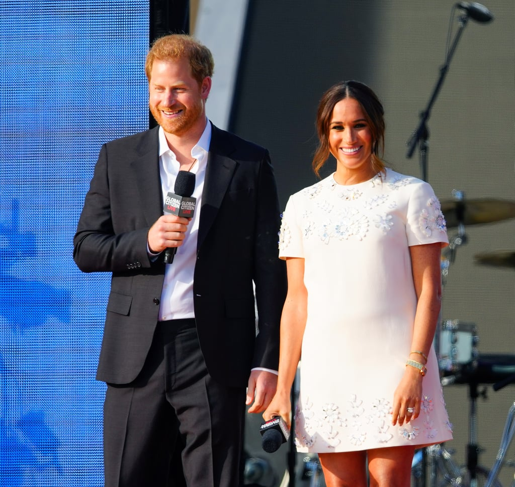 """Prince Harry and Meghan Markle have touched down in NYC! Ahead of their appearance at Global Citizen Live this weekend, the couple visited the One World Observatory on Thursday alongside Mayor Bill de Blasio; the mayor's wife, Chirlane McCray; their son, Dante de Blasio; and Governor Kathy Hochul. The two looked at ease as they held hands and smiled for the cameras. The appearance marked Harry and Meghan's first joint outing since the birth of their daughter, Lili, in June.  The following day, the couple visited students in Harlem, where Meghan read her children's book The Bench to a group of kids. """"I wrote this when we just had our little boy, and I haven't read it to any other kids but you!"""" she told them, according to People. """"The idea of representation — 'That looks like me!' — I wanted everyone to be included in this book."""" On Sept. 25, Meghan and Harry attended the Global Citizen Live event in Central Park and gave a speech calling for COVID-19 vaccine equity. """"We know that it feels like this pandemic has been going on forever — we get it, it is a lot — and some people are just over it,"""" Meghan said. """"But if everyone's over it, it's never going to be over. There is so much that we can do today, now, that can get us closer to ending this pandemic and that's why we're all here."""" Taking the mic, Harry added, """"We're battling more than the pandemic alone. This is a battle of misinformation, bureaucracy, lack of transparency, and lack of access. And above all, this is a human rights crisis . . . My wife and I believe that where you're born should not dictate your ability to survive."""" The last time we saw Meghan in NYC was in 2019 when she proudly supported Serena Williams at the US Open and held a baby shower with close friends for son Archie. When asked about her return to the city on Thursday, Meghan replied, """"It's wonderful to be back, thank you."""" See more pictures from their latest visit and a video of thier Global Citizen Live speech ahead.       Related:      """