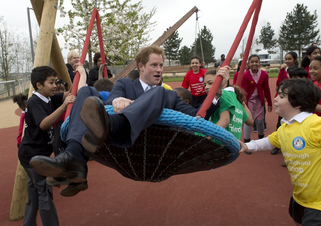 Prince Harry played with children during a visit to the Queen Elizabeth Olympic Park in London on Friday.