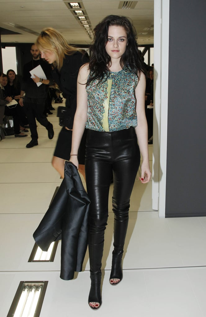 Kristen Stewart dressed in leather pants and a printed top.
