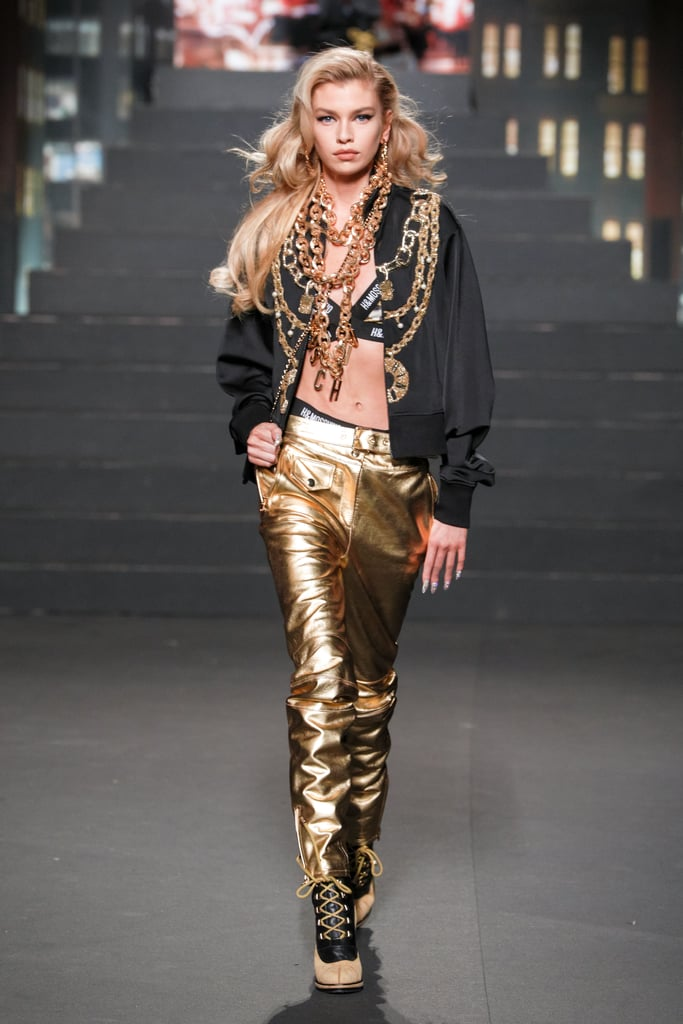 Stella Maxwell Wore a Logo Bralette With Gold Pants