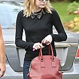 Emma Stone carried a Burberry handbag in LA.