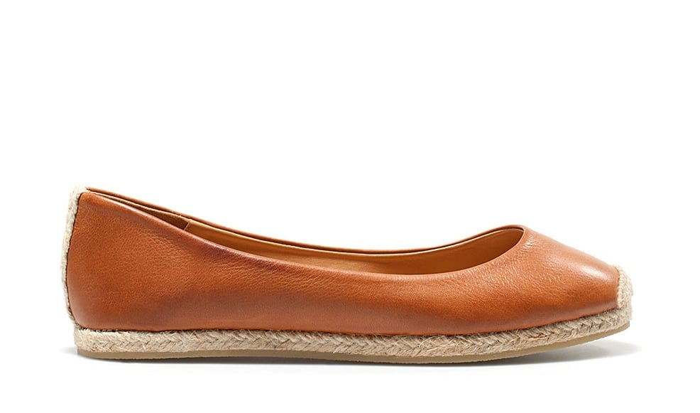 """Evoke a summery vibe — without veering into beach-ready territory — with a leather ballet flat infused with a jute sole. We call this the perfect example of having """"the best of both worlds."""" Zara Jute Ballerina ($70)"""