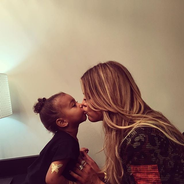 """On Friday, the Kardashians shared a series of backstage selfies from Kanye West's show. Capturing everything from peace signs to duck lips, the famous clan served up some serious Instagram game, per usual. But the best snap of the night came from Khloé Kardashian, who posted a frame-worthy kiss with her 2-year-old niece, North West. """"Northy and KoKo LoCo at daddy's show,"""" Khloé captioned the shot. Read through for more snaps from the Kardashian crew, then take a look at Kourtney's recent trip to Montana and all of Kim's second-pregnancy appearances — so far!"""