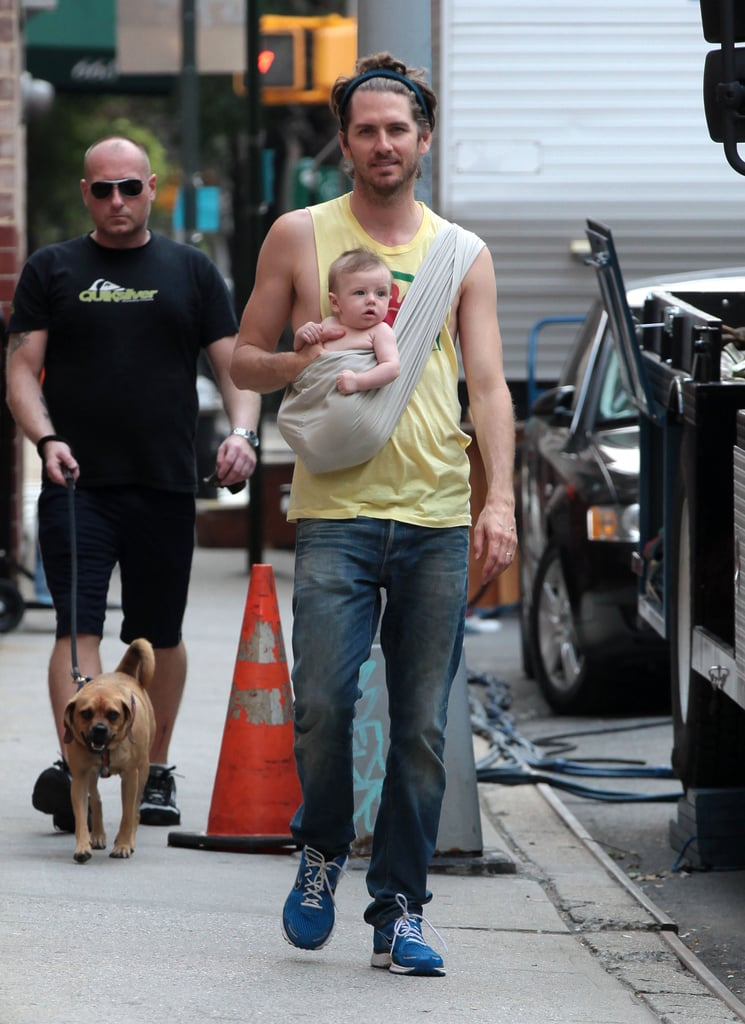 Christopher Jarecki kept baby Bear Blu comfortable in a sling while visiting mama Alicia Silverstone on set.