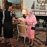 In 2009, the Obamas met Queen Elizabeth II and Prince Philip for the first time at Buckingham Palace.