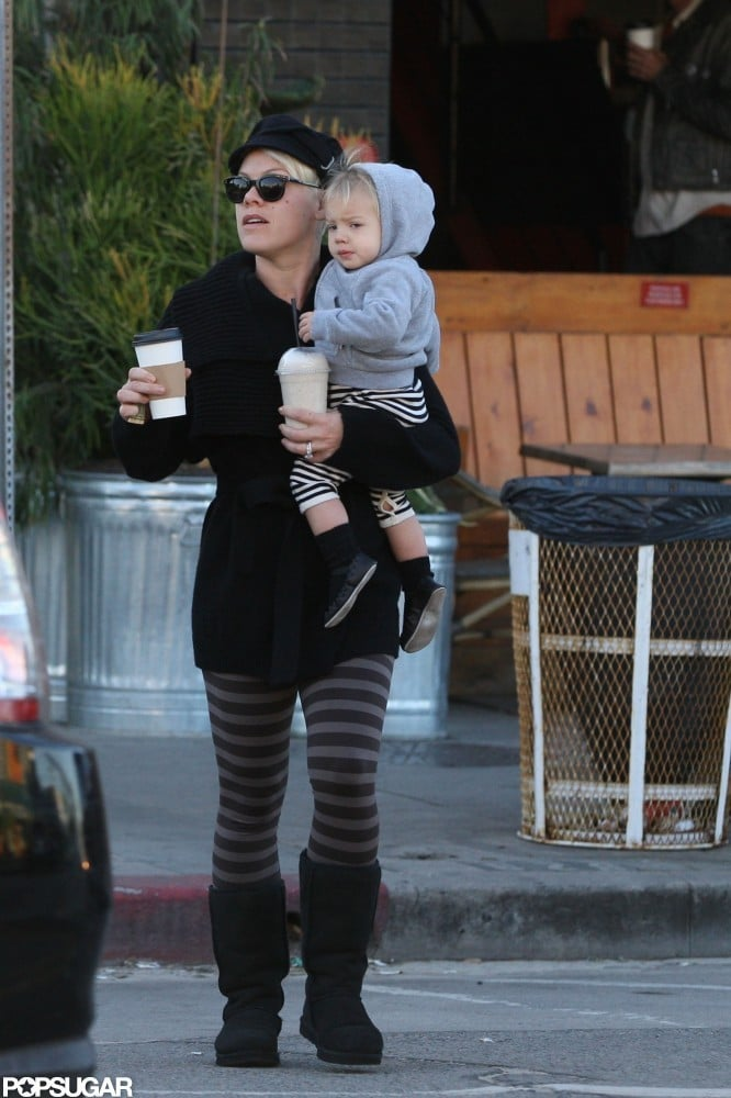 Pink balanced two coffees and Willow Hart as she crossed the street.